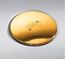 Hüppe EasyStep Sifon se zlatou krytkou a se stavební výškou 70mm a s průtokem až 0,6l/s. Výška zápachové uzávěry 50mm